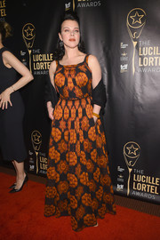 Debi Mazar attended the Lucille Lortel Awards wearing an ochre and black print gown.