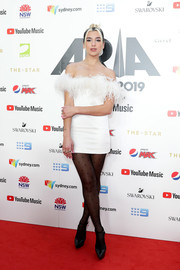 Dua Lipa got frilled up in a Saint Laurent off-the-shoulder LWD with a feathered neckline for the 2019 ARIA Awards.
