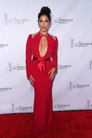 Stephanie Beatriz sent temperatures rising with this cleavage-baring red gown at the Imagen Awards.