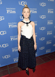 Saoirse Ronan showed off her shoulders and arms in a white Chanel halter top with pendant necklace detail at the Santa Barbara International Film Festival.