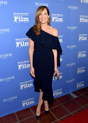 Allison Janney looked simply lovely in a navy off-one-shoulder dress by Christian Siriano at the Santa Barbara International Film Festival.