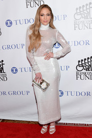 Jennifer Lopez shimmered in a white sequined turtleneck by Sally LaPointe at the Great Sports Legends Dinner.
