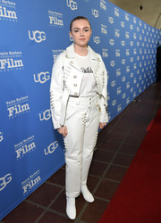Elsie Fisher completed her all-white attire with a pair of ankle boots.