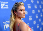 Florence Pugh attended the Virtuosos Award presentation during the 2020 Santa Barbara International Film Festival wearing a pair of hot-pink snap hook earrings with diamond accents.
