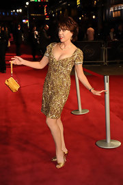 Kathy Lette dazzled at the '360' premiere in a gold beaded dress paired with metallic gold heels.