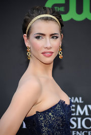 Jacqueline MacInnes Wood wore a dramatic loose updo with a gold hairband at the Daytime Emmys.