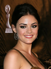 Lucy Hale paired her elegant hairstyle with tiered gemstone earrings.