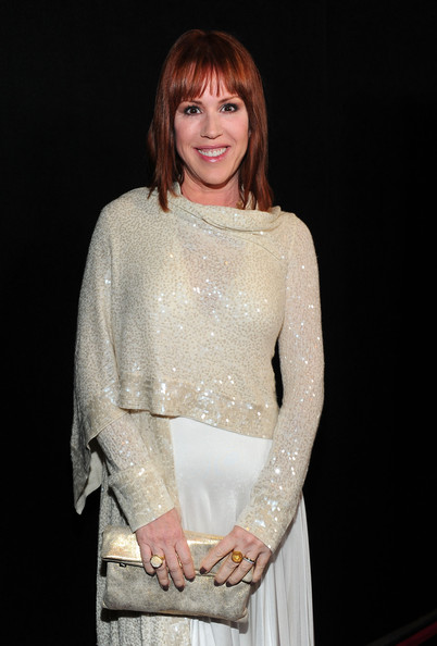 Molly Ringwald was obviously in the mood for some sparkle, pairing a metallic gold clutch with her sequined outfit.