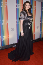 Lynda Carter was all glammed up in an embellished black gown with a fur stole when she attended the Kennedy Center Honors Gala.