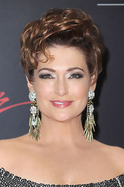 Carolyn Hennesy showed off her embellished earrings while hitting the Daytime Emmy Awards.