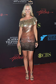 Sharon Case paired her strappy gold sandals with a sequin muti-toned cocktail dress.