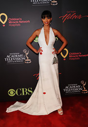 Denise Vasi sexily posed on the red carpet wearing a halter dress with a plunging neckline.