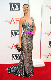 Gisele donned a glamorous evening gown with a magenta belt at the AFI Life Achievement Awards.
