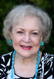 Betty White added a bit of color to her look with Turquoise stone earrings.