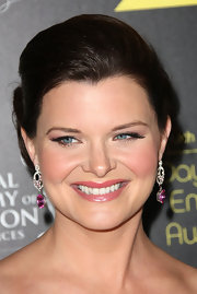 Heather Tom's green eyes dazzled in false eyelashes.