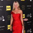 Sharon Case in a one-shoulder crimson gown