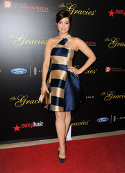 Bellamy Young was bold and sophisticated in a blue and gold one-shoulder cocktail dress during the Gracie Awards.