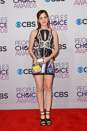 Emma Watson got creative at the People's Choice Awards in this artistic print cutout dress.