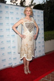Nicole Kidman kept the glitz going with a pair of gold evening sandals by Rupert Sanderson.