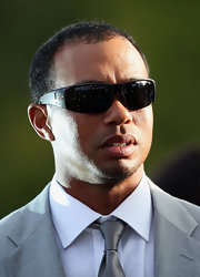 Tiger Woods sported black shield shades for his sporty but dressy look at the Ryder Cup Opening.