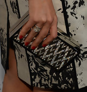 Sophia Bush complemented her printed shift with this eye-catching, glittery printed clutch.
