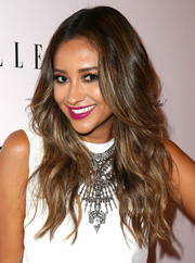 Shay Mitchell accessorized with an attention-grabbing silver statement necklace.