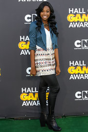 Coco Jones contrasted her sleek outfit with a pair of chunky boots to stay true to her youthful charms at the Cartoon Network's Hall of Game awards.