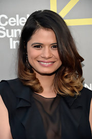 Melonie Diaz showed off her caramel ombre locks with a loose and wavy 'do that tumbled delicately over her shoulders.