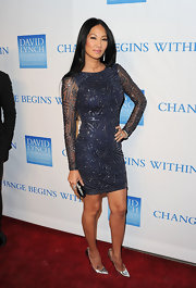 Kimora Lee Simmons added a touch of shine to her ensemble with silver stilettos.