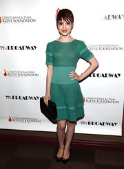 Sami Gayle complemented her lovely dress with a simple black leather clutch.