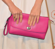 Abigail Spencer brought some color to her white frock with this oversized fuchsia clutch.