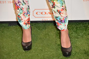 Emmanuelle Chriqui chose classic black platform pumps to pair with her printed pants at the Coach CDF benefit.