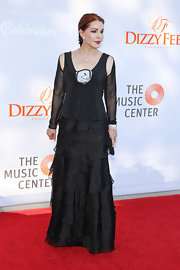 Pricilla Presley showed us how she caught the King's attention when she donned this elegant black tiered dress.