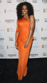 Kelly Rowland wore an orange silk chiffon dress to the Black Women in Music event.
