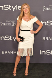 Connie Britton completed her sleek and chic look with a black box clutch.