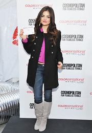 Lucy Hale looked winter chic in a black military style pea coat.