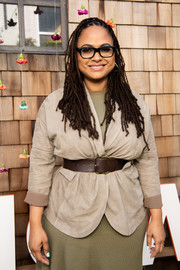 Ava DuVernay attended the National Day of Racial Healing wearing a nude jacket, which she cinched with an oversized brown leather belt.