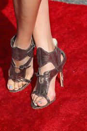 Jeannie Mai attended the Streamy Awards looking chic and modern in her bronze gladiator heels.