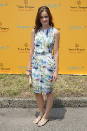 Alexis looked lovely in a watercolored sheath dress with a draped skirt.