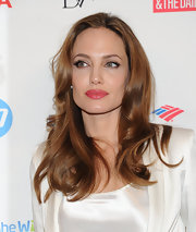 Angelina Jolie wore her glossy locks in smooth waves at the 3rd Annual Women in the World Summit.