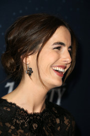 Camilla Belle attended the unite4:humanity event rocking a pair of John Hardy cobra earrings.