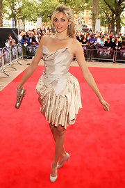 Tamsin Egerton matched her cocktail dress with a pair of nude pumps.