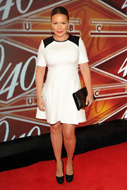 Angie Martinez sported a white fit-and-flare dress with leather shoulder panels at the 40/40 Club in NYC.