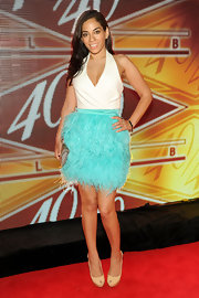 Sharon Carpenter wore this white and turquoise halter dress that featured a feathered skirt.