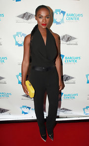 Tika Sumpter chose a sophisticated black cowl-neck jumpsuit for the grand opening of the 40/40 Club.