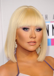 After months of sporting long ombre curls, Christina debuted this  fierce Cleopatra-inspired bob at the 2012 AMAs. We love!