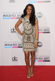 Kelly Rowland rocked this stunning paneled and printed body-conscious mini-dress at the 2012 American Music Awards.