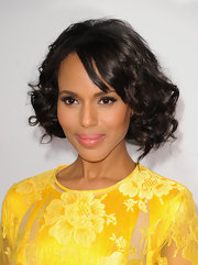 With curls so perfectly placed, you'd never know that Kerry's ultra-romantic bob was actually fake! The actress pinned up her long raven tresses to give the illusion of this short, full style.