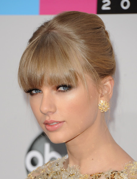 Taylor Swift's French Twist and Flawless Glow