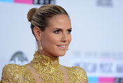 Heidi Klum charmed on the AMA red carpet with a chic, slicked-back bun.